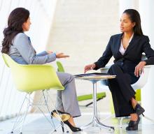 two professional ladies talking
