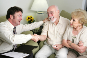 elderly couple talking to their doctor